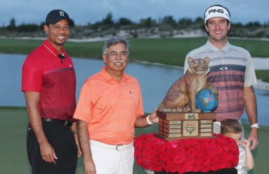 NASSAU, BAHAMAS - DECEMBER 06: Tiger Woods, Pawan Munja of Hero Motocycles and Bubba Watson pose with the trophy after Watson's three-stroke victory at the Hero World Challenge at Albany, The Bahamas on December 6, 2015 in Nassau, Bahamas   Scott Halleran, Image: 268453502, License: Rights-managed, Restrictions: , Model Release: no, Credit line: Profimedia, AFP