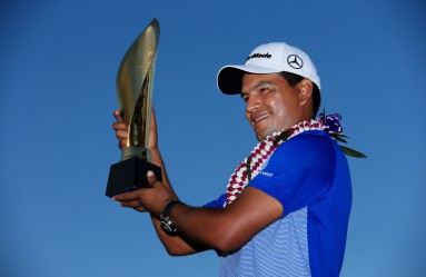 HONOLULU, HI - JANUARY 17: Fabian Gomez of Argentina celebrates with the winner's trophy after defeating Brandt Snedeker during a playoff during the final round of the Sony Open In Hawaii at Waialae Country Club on January 17, 2016 in Honolulu, Hawaii.   Tom Pennington, Image: 271594382, License: Rights-managed, Restrictions: , Model Release: no, Credit line: Profimedia, Getty images
