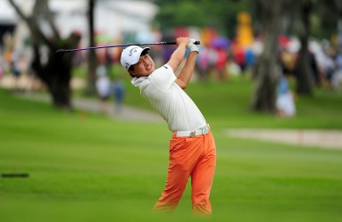 """This handout photo taken and released by Lagardere Sports on January 31, 2016 shows Jeunghun Wang of South Korea hitting a shot during the final round of the Singapore Open at the Sentosa Golf Club in Singapore. The one million USD event is taking place from January 28 to 31, Image: 272778537, License: Rights-managed, Restrictions: --- EDITORS NOTE --- RESTRICTED TO EDITORIAL USE - MANDATORY CREDIT - """"AFP PHOTO / LAGARDERE SPORTS / Khalid Redza"""" - NO MARKETING NO ADVERTISING CAMPAIGNS - DISTRIBUTED AS A SERVICE TO CLIENTS, Model Release: no, Credit line: Profimedia, AFP"""