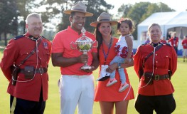 Jul 30, 2017; Oakville, Ontario, CAN; Jhonattan Vegas poses with  Canadian Mounties and the Canadian Open trophy while his wife Hildegard holds their daughter Sharlene after winning the RBC Canadian Open golf tournament at Glen Abbey Golf Club., Image: 343514334, License: Rights-managed, Restrictions: *** World Rights ***, Model Release: no, Credit line: Profimedia, SIPA USA