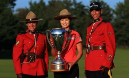 OTTAWA, CANADA - AUGUST 27: Sung Hyun Park of Korea celebrates with the trophy and 2 Canadian Mounties after winning the Canadian Pacific Women's Open following the final round at the Ottawa Hunt & Golf Club on August 27, 2017 in Ottawa, Canada.   Vaughn Ridley, Image: 347379624, License: Rights-managed, Restrictions: , Model Release: no, Credit line: Profimedia, Getty images