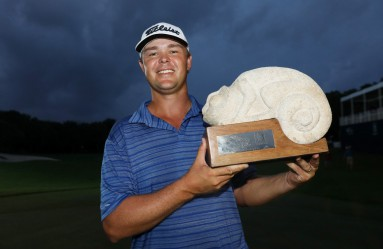 PLAYA DEL CARMEN, MEXICO - NOVEMBER 12: Patton Kizzire of the United States celebrates with the trophy on the 18th green after winning during the final round of the OHL Classic at Mayakoba on November 12, 2017 in Playa del Carmen, Mexico.   Rob Carr, Image: 355208172, License: Rights-managed, Restrictions: , Model Release: no, Credit line: Profimedia, Getty images